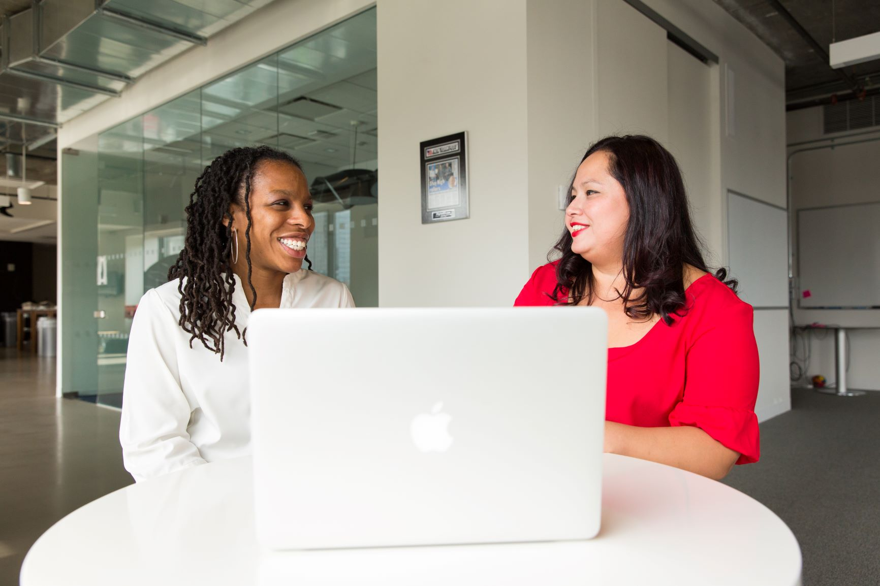 Canva - Two Women in Front of Silver Macbook (1)